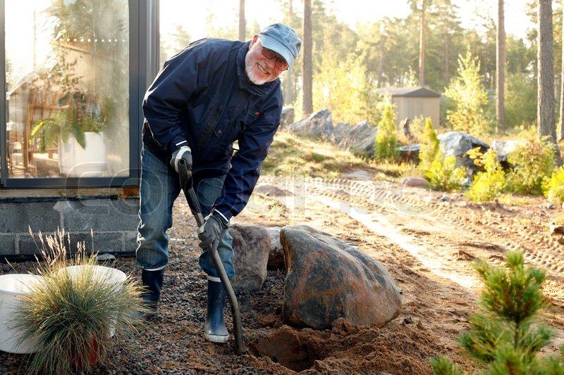 Gardener digs a hole 5
