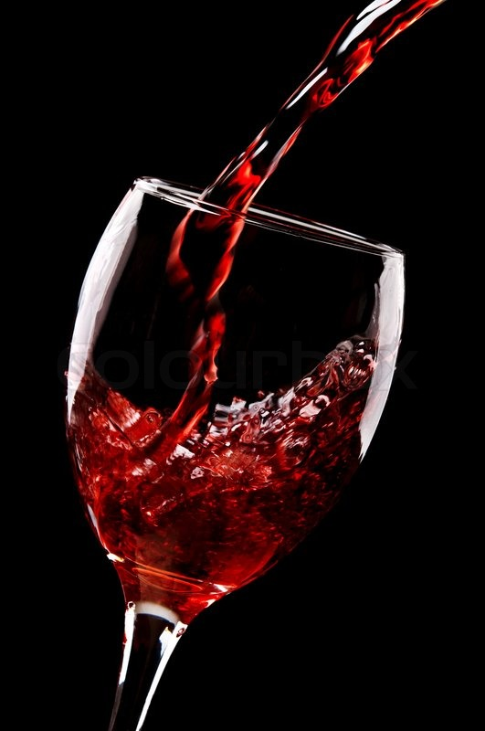 red wine pouring into glass stock photo colourbox