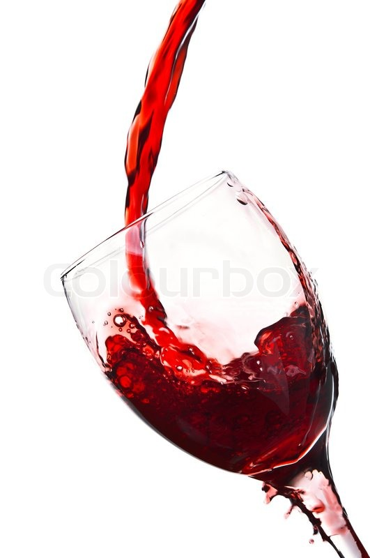 Red wine pouring into wine glass | Stock Photo | Colourbox