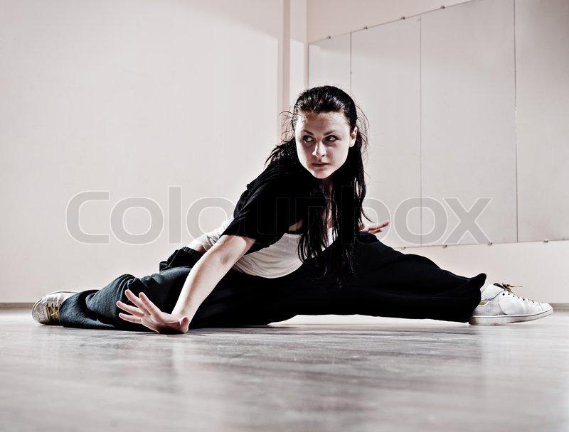 Hip-hop girl in dance motion, stock photo