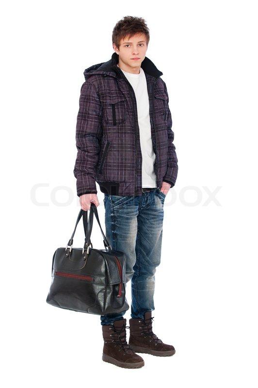 Man in coat holding bag | Stock Photo | Colourbox