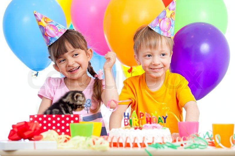 Happy kids girl and boy celebrating birthday party Stock Photo