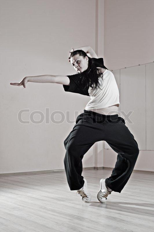 Pretty hip-hop girl in dance, stock photo