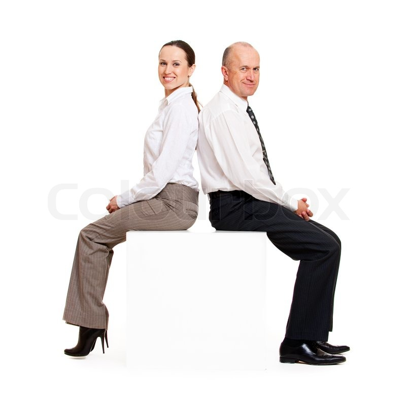 Smiley Business People Sitting On The Stock Photo