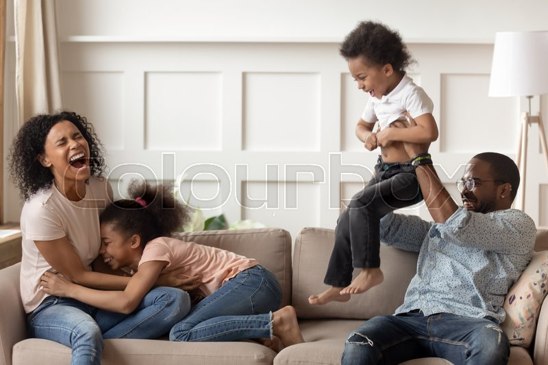Happy Black Family Having Fun Laughing Stock Image Colourbox