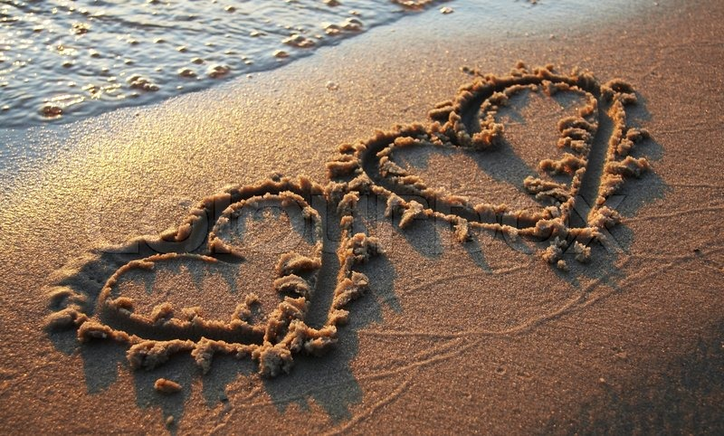 Two hearts on sand | Stock Photo | Colourbox