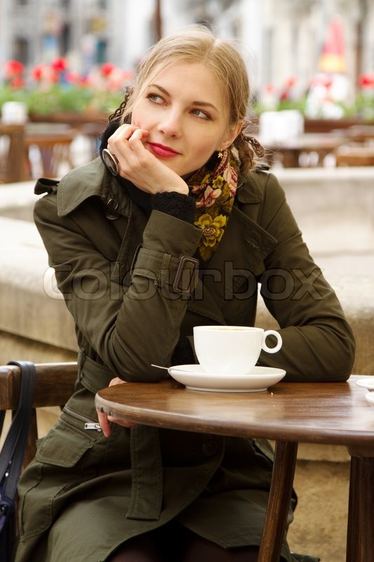 Happy Young Woman Drinks Coffee