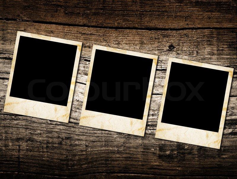 Grunge Vintage Photo Frames On A Wood Stock Photo
