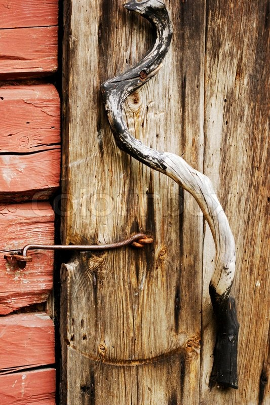 Close-up of juniper wooden door handle on very old door | Stock ...