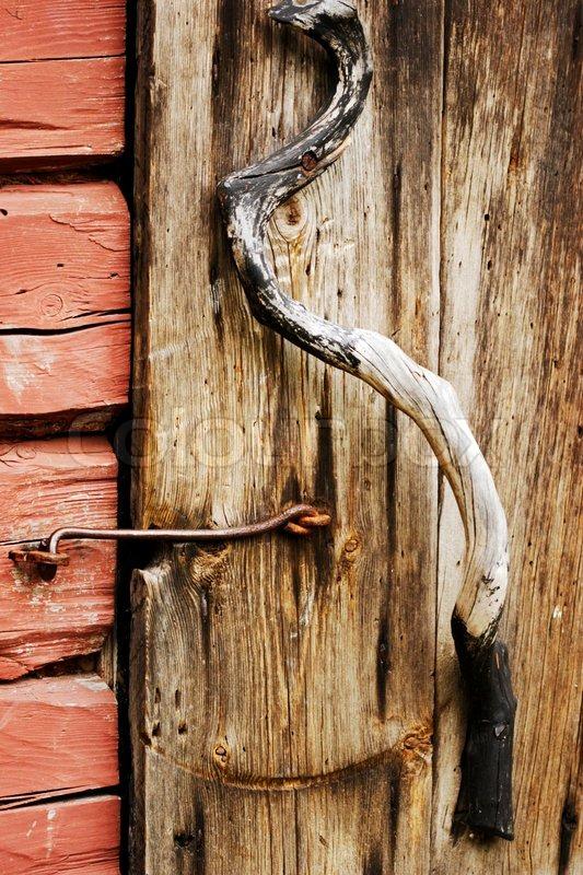 Close Up Of Juniper Wooden Door Handle On Very Old Door