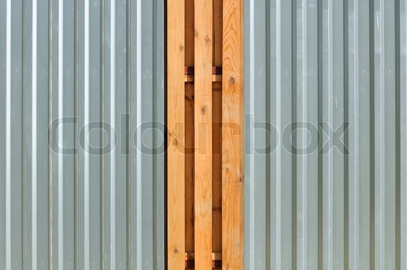 Stock image of 'Metal Fence with Wood Inserts'