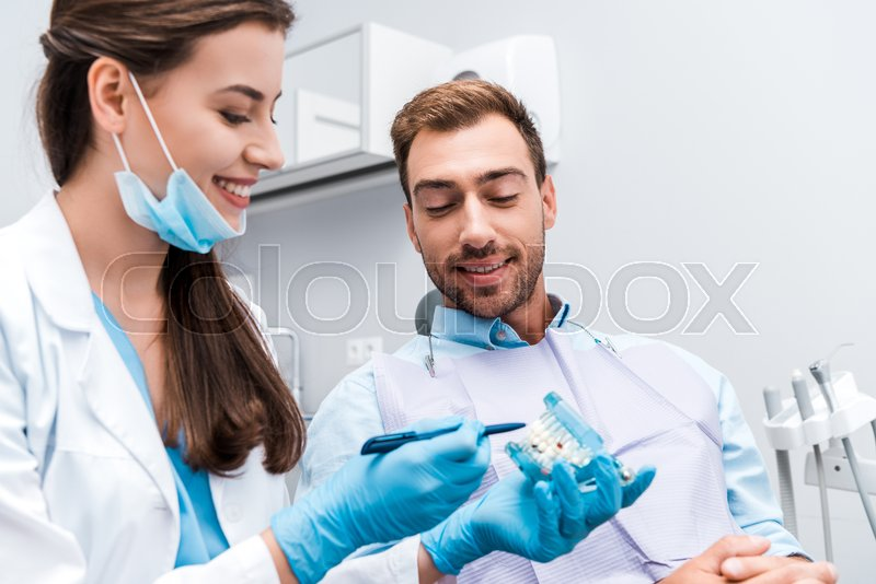 Selective focus of attractive dentist ...