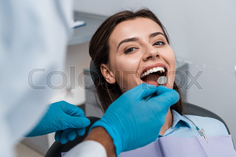 Selective focus of dentist in latex ...