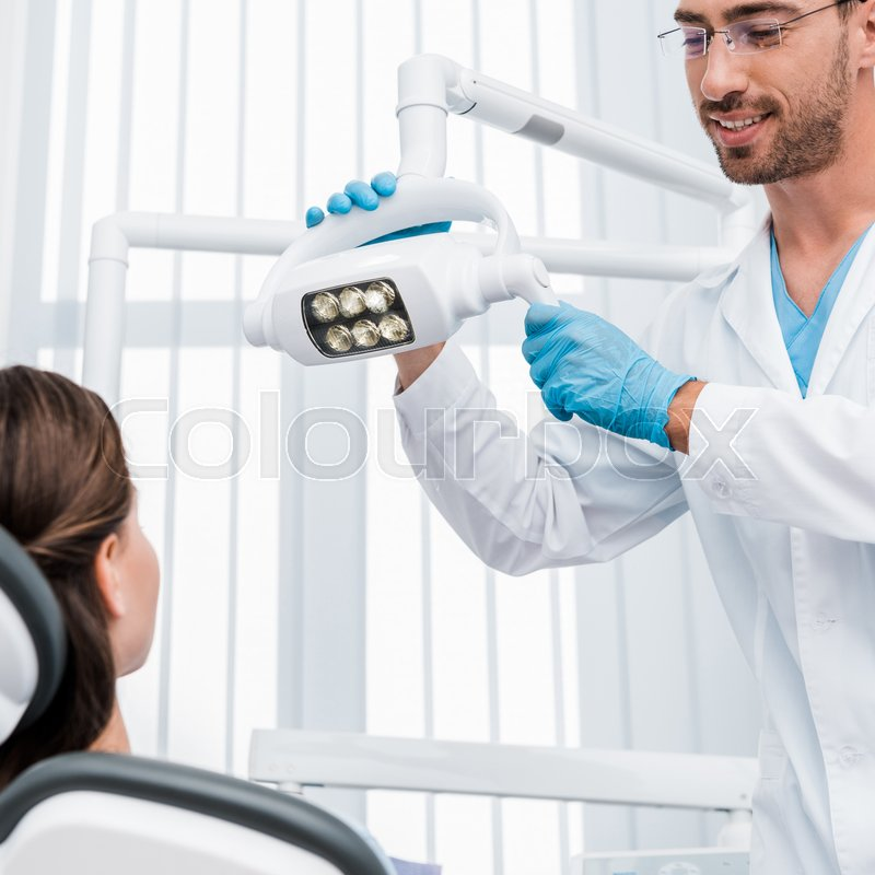 Selective focus of handsome dentist in ...