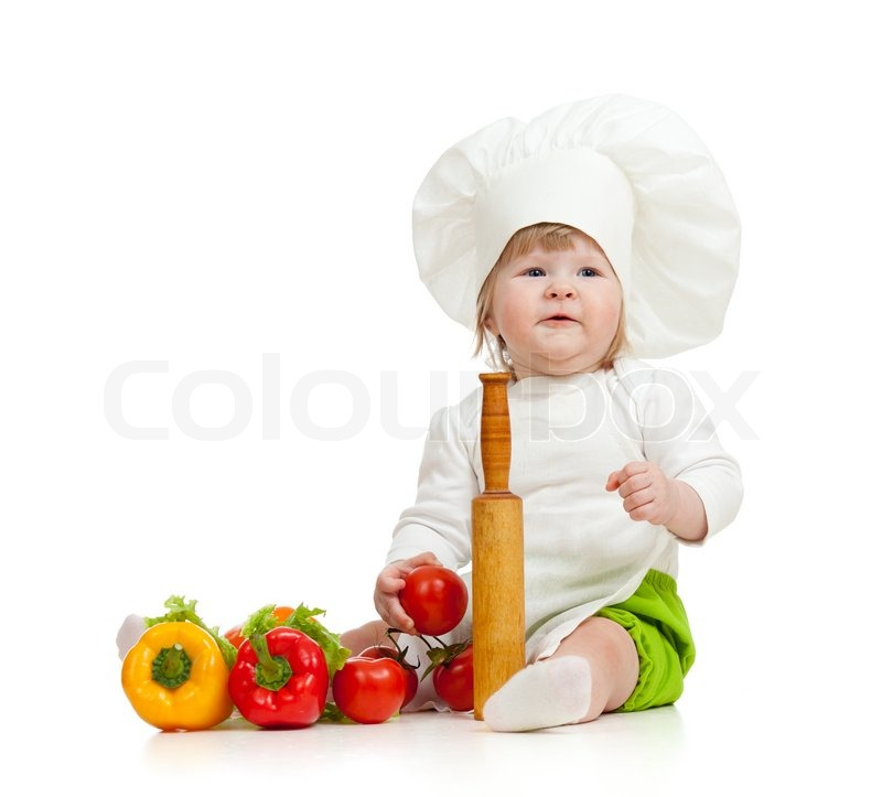 Kid in chef hat with healthy food vegetables | Stock Photo ...