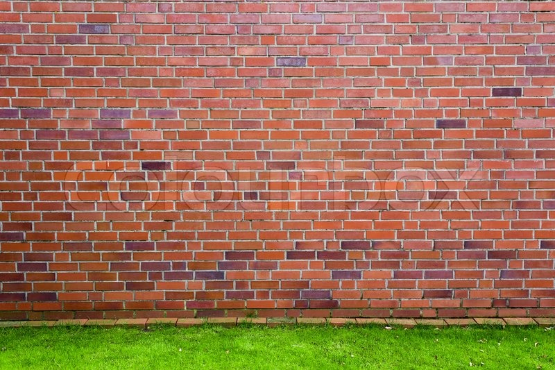 Red Brick Wall With Green Grass Stock Photo Colourbox