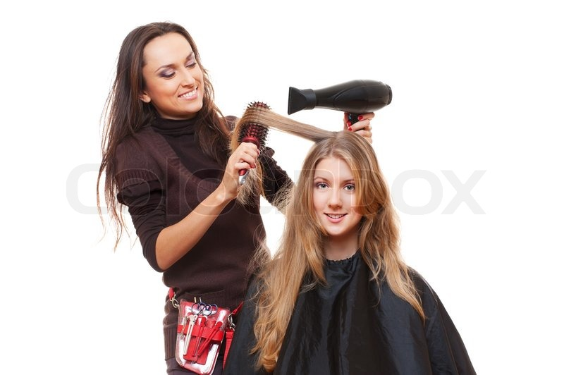 Studio shot of hairdresser and young woman isolated on ...
