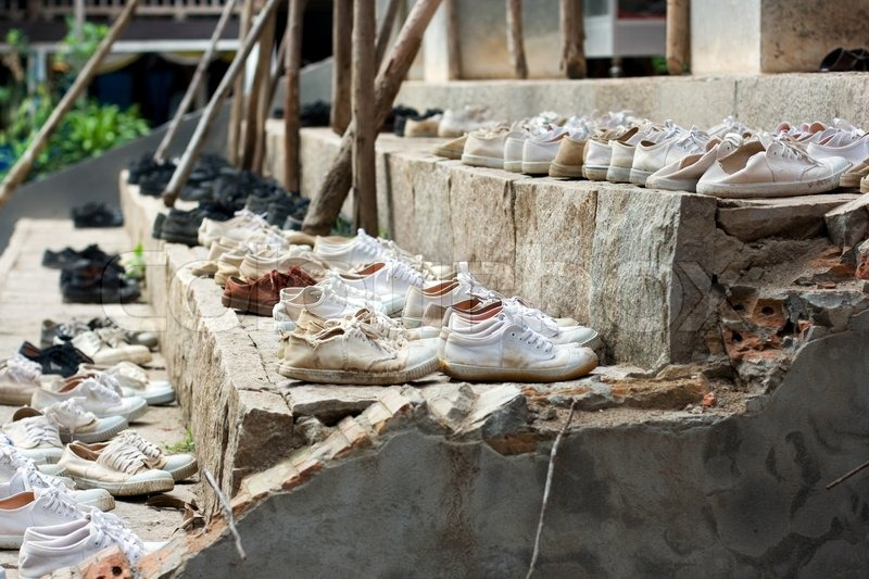 Many shoes on stairs, stock photo
