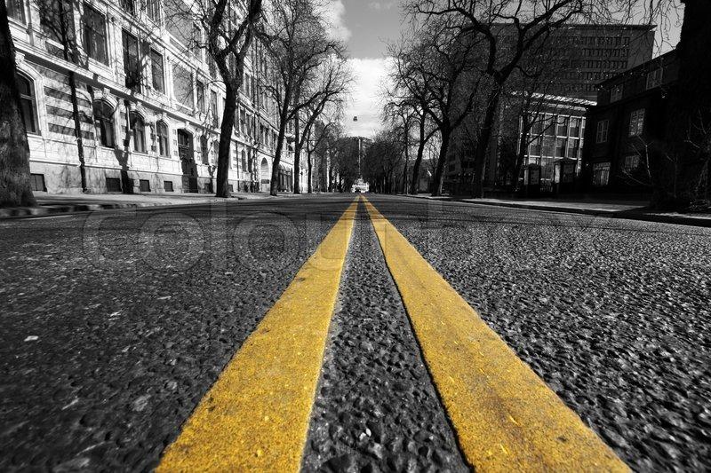 Double yellow lines in city street | Stock Photo | Colourbox