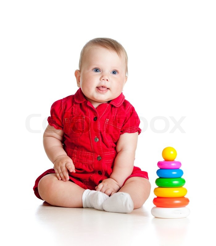 Baby girl playing with toy isolated on white background ...