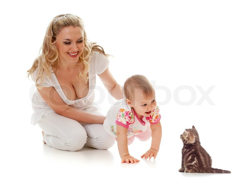 Stock image of 'Kid and loving mother girl steps on her hands forward to small kitten'