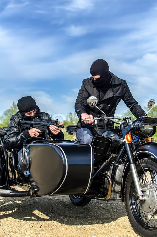 Two Armed Men Riding A Motorcycle With Stock Photo