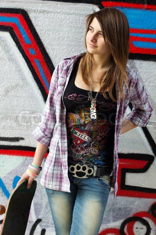 Pretty skater girl holding skateboard   Stock Photo ...