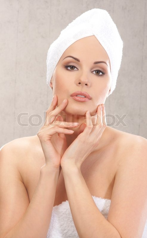Young attractive woman in towel, stock photo