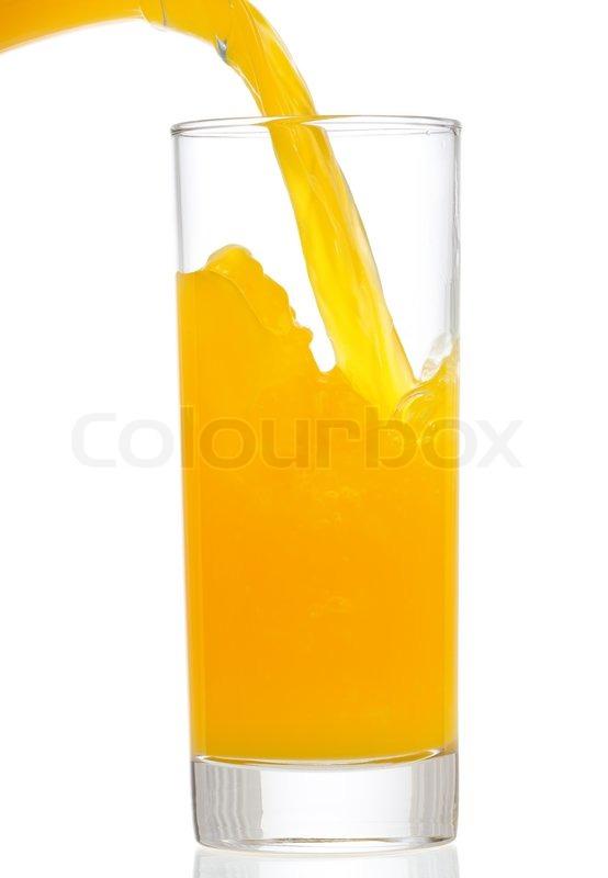 orangensaft ist in glas gie en stockfoto colourbox. Black Bedroom Furniture Sets. Home Design Ideas