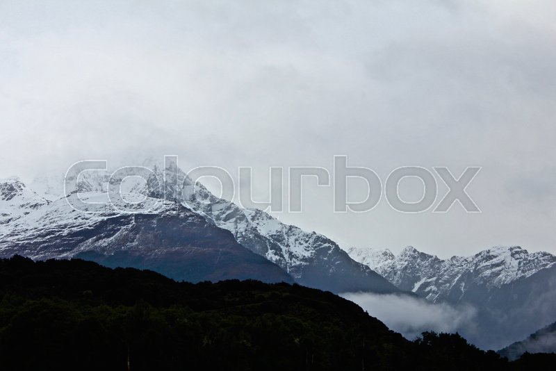 A mountain covered with snow shrouded ...