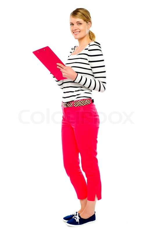 woman standing with clipboard stock photo colourbox