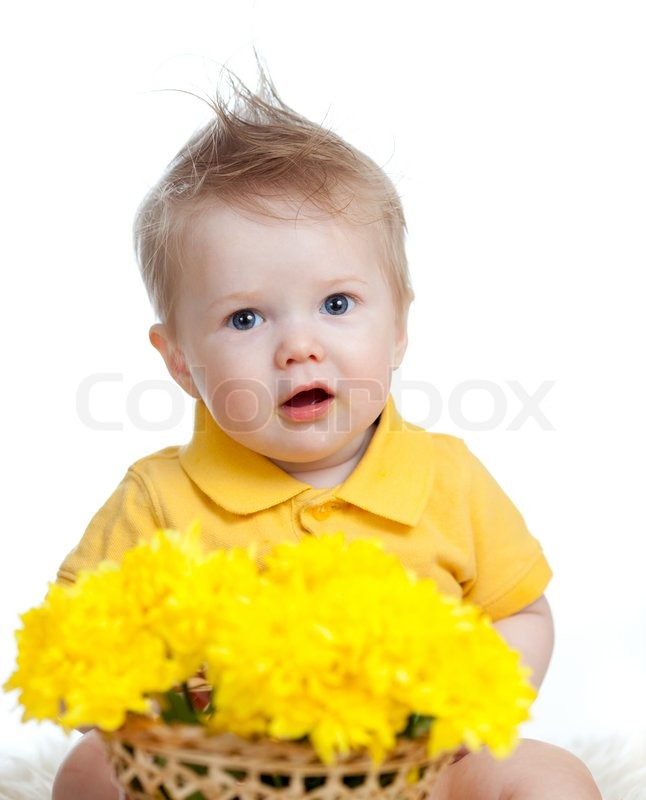 cute baby boy holding basket with yellow flowers stock photo
