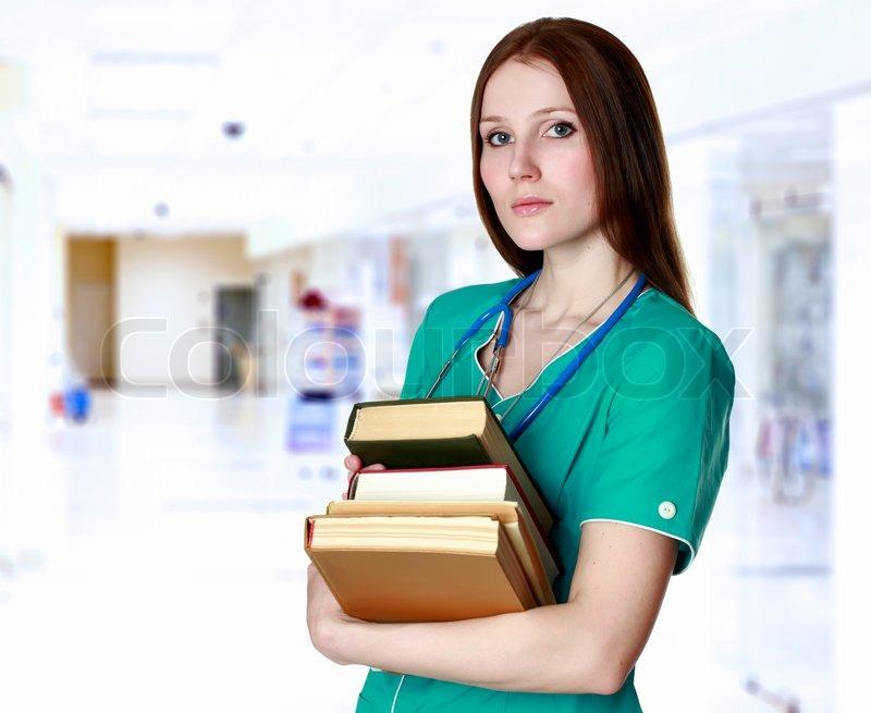 Pretty Nurse Or Doctor With Books Stock Photo Colourbox