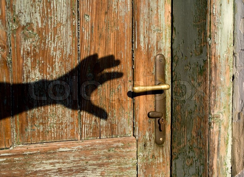 Shadow Of Hand And Old Door Stock Photo Colourbox