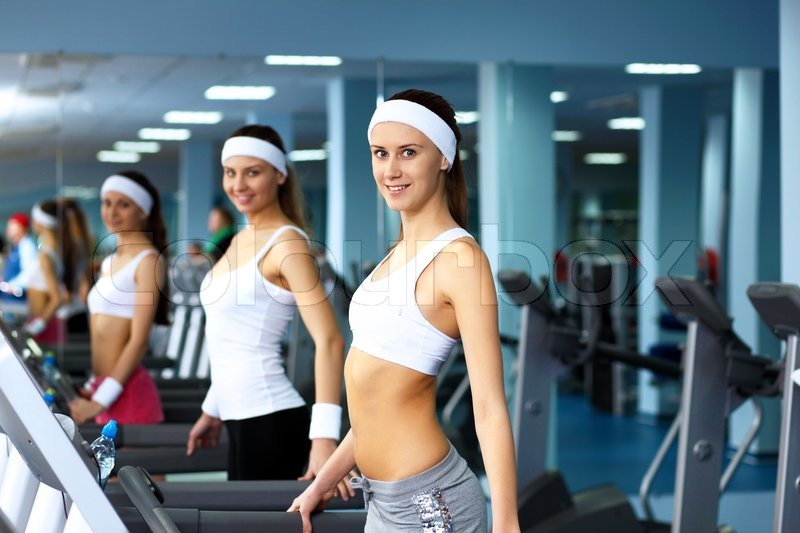 Woman in sport wear doing sport in gym, stock photo