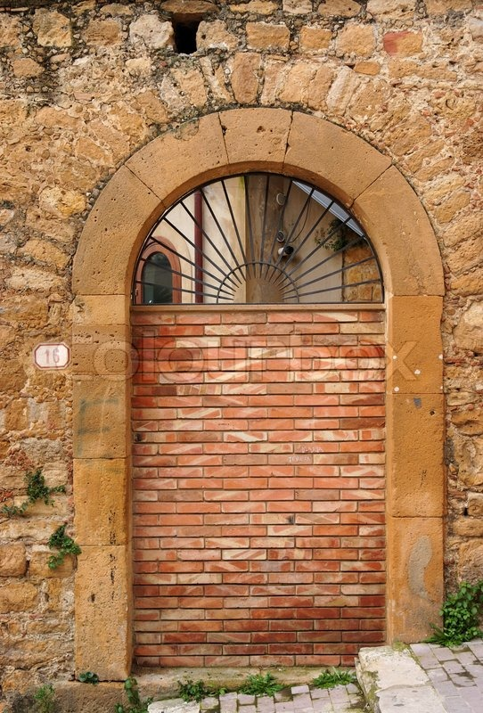Old Arched Door Blocked By Brick Wall Stock Photo