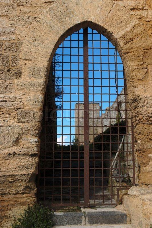 Barred Gate Off Castello Di Lombardia Stock Photo
