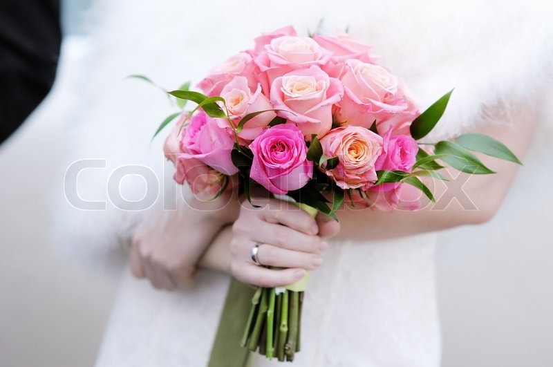 Bride holding beautiful wedding flowers bouquet | Stock Photo ...