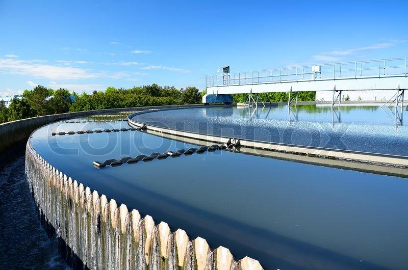 Modern urban wastewater treatment plant, stock photo