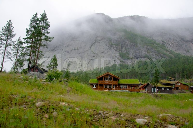 Typical norwegian house in the village stock photo colourbox - The house on the rock the ultimate refuge in a norwegian fjord ...