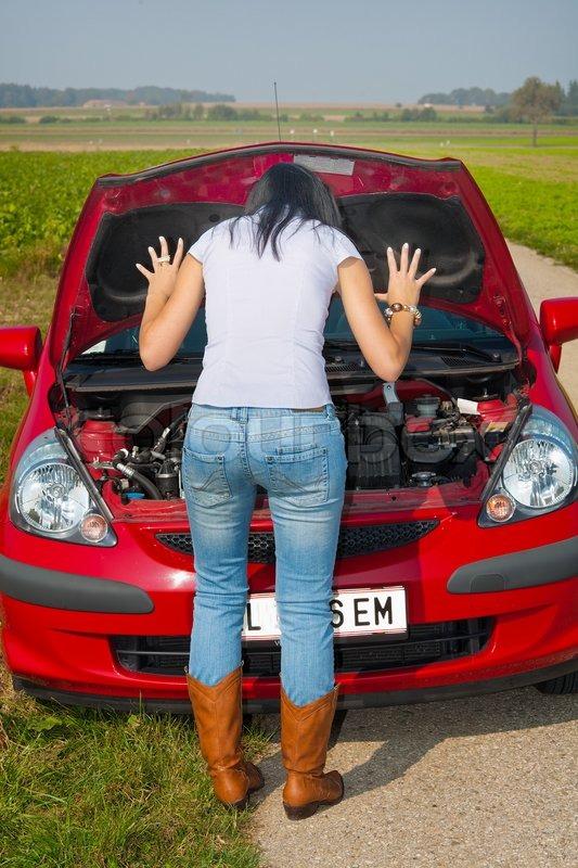 Woman in her car broke down engine failure   Stock Photo   Colourbox