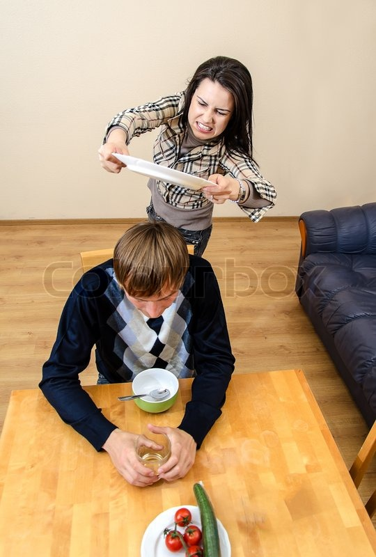 domestic violence  wife beating her husband with a plate