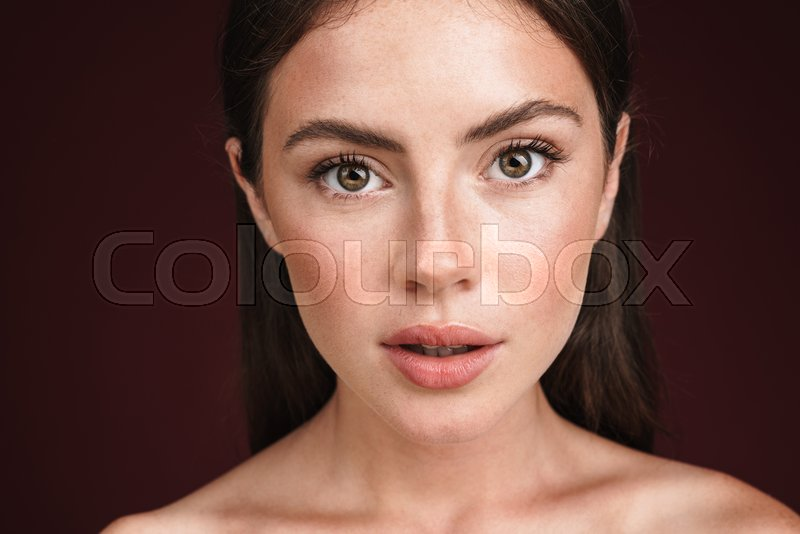 Beauty portrait of a young attractive half naked woman