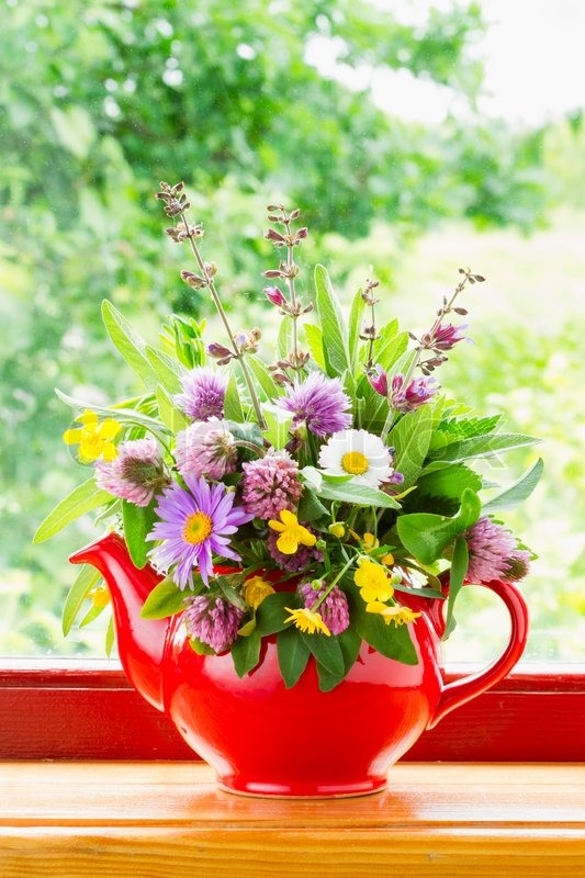 Red Teapot With Bouquet Of Healing Herbs And Flowers On