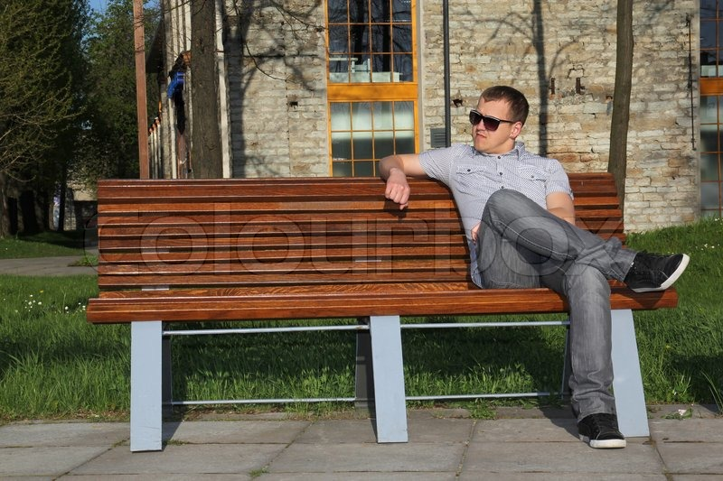 Man Sitting In Park On The Bench Stock Photo Colourbox