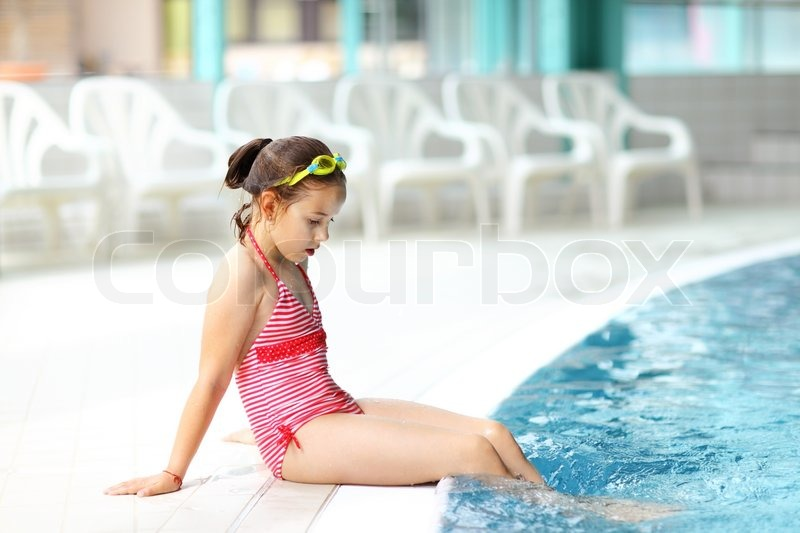 Child Relaxing By Swimming Pool Stock Photo Colourbox