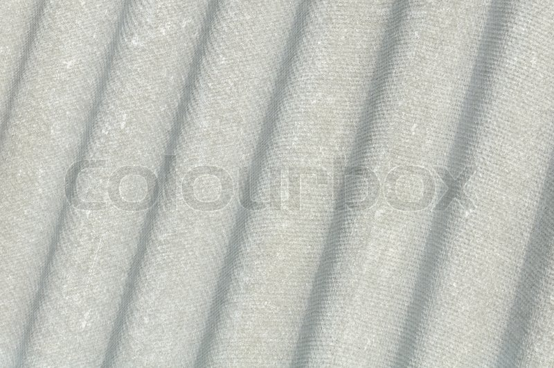 Stock image of 'Corrugated Asbestos Cement Roof Sheet Eternit'