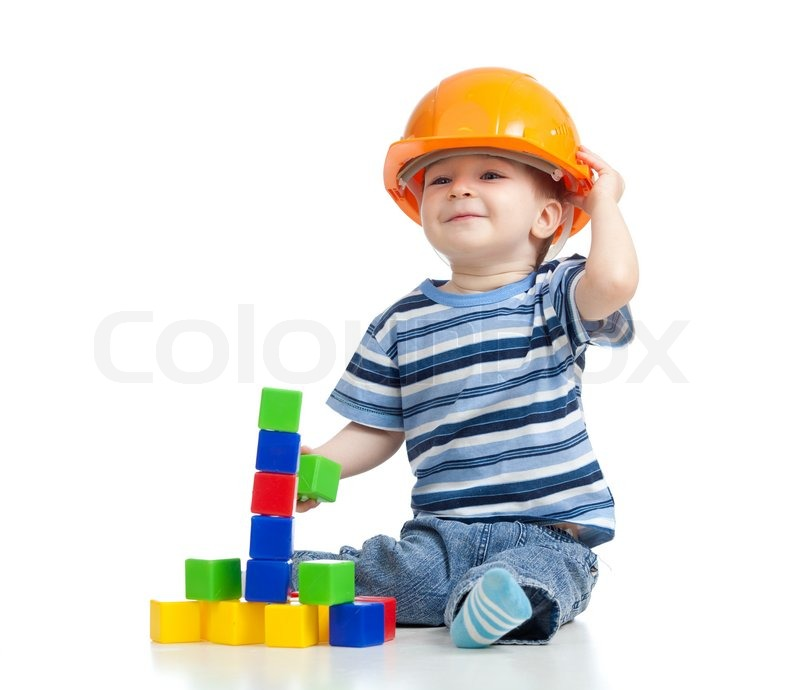 Kid playing with building blocks toy | Stock Photo | Colourbox