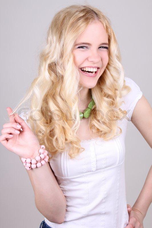Funny blonde girl in studio, stock photo