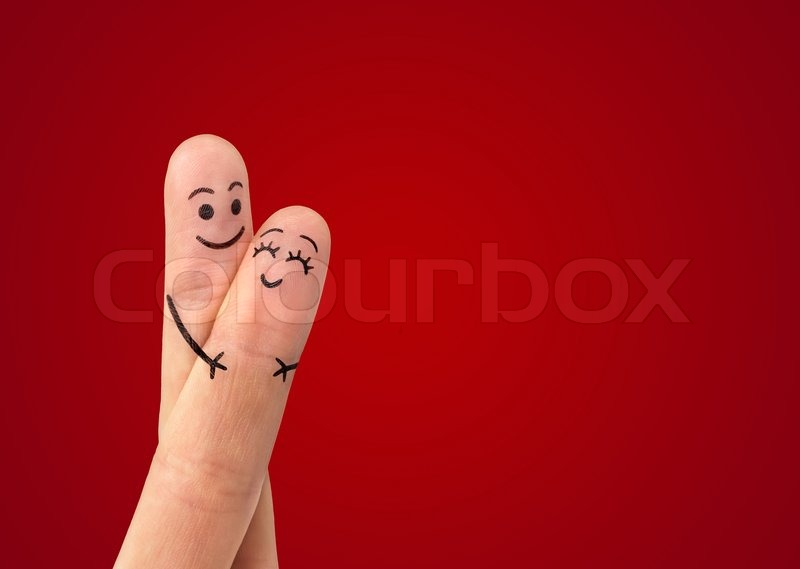 stock photo happy couple love with painted smiley hugging